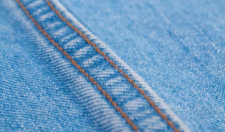 Extreme close up - double seam on jeans. Texture, textile background. Macro shooting