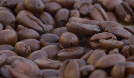 Extreme close up of coffee beans. Texture, food background. Macro shooting