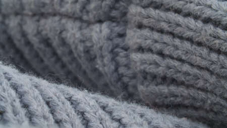 Extreme close up thick gray wool knitted sweater. Texture, textile background. Macro shooting