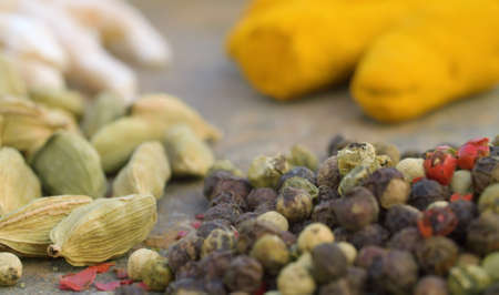 Macro shot spices on the table. Pepper, cardamom, turmeric. Extreme close up 写真素材