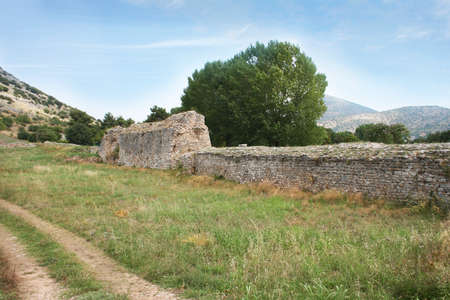 Ruins of the walls at the Philippi archaeological site. Philippi was visited by the Apostle Paul and his companions during the missionary journey recorded in the Bibles book of Acts. This portion of the road is from Ancient Philippi.