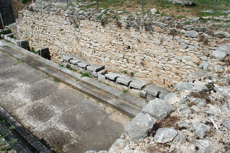 These are the public toilets at the ruins from Ancient Philippi. These toilets date to the 3rd century AD. Philippi was the home of Lydia the merchant who befriended the Apostle Paul in Acts 16 of the Bible. Banco de Imagens - 98622307