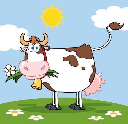 乳牛牧草地に口の中で花を持つ