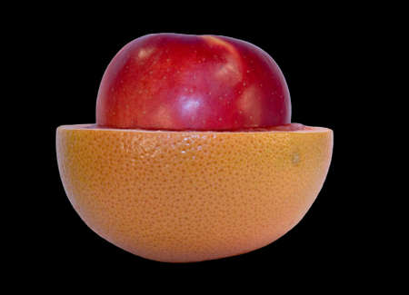 progeny: Grapefruit and apple isolated on black background with clipping path Stock Photo