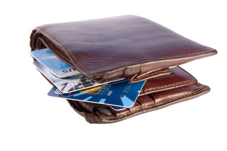 Old wallet with credit cards inside, isolated on white background with clipping path photo