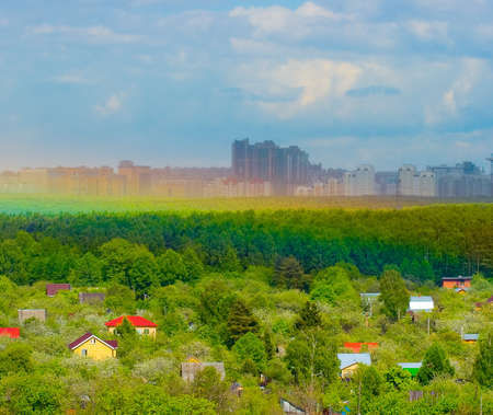 onslaught: The Stand near Moscow: Countryside, forest line, wall of rain and rainbow VS frontal attacking city. Village in focus, City - under rain counter-attack