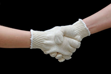 Labor handshake with safety gloves isolated on black photo
