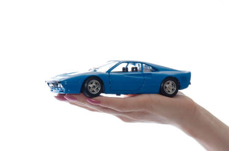 auto leasing: Car toy on palm Stock Photo