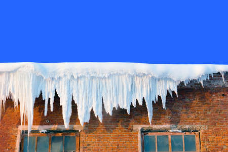 icicles: Snow cover on roof of old textile fabric with icicles