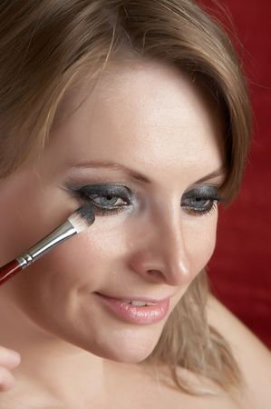 Woman is doing morning make up photo