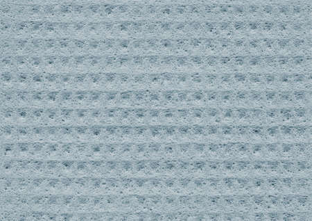 spongy: Light blue texture of porous spongy material close-up. Abstract fabric background for design Stock Photo