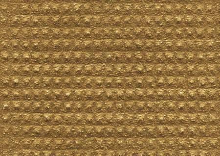 yellow  ochre: Gold, ochre texture of the porous relief material is close-up. Abstract wall surface background for design