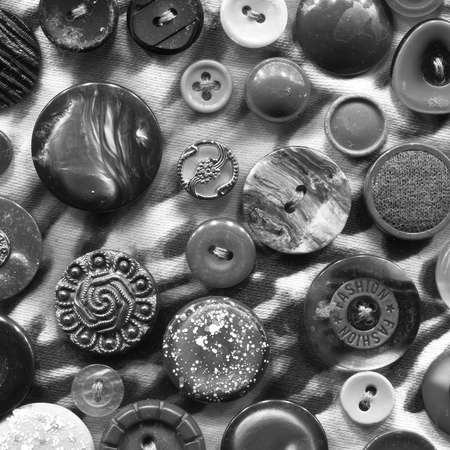 fabric textures: Abstract black and white background of buttons. Buttons of the circle shape of variation textures randomly arranged in the form of a pattern on a fabric