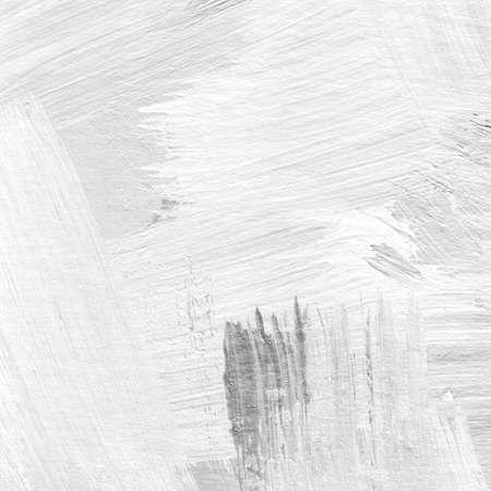 グレーと黒の色合いでブラシ ストロークとテクスチャの抽象的な背景の白い。ブラシ ストロークをキャンバスにアクリル画の断片。現代美術。