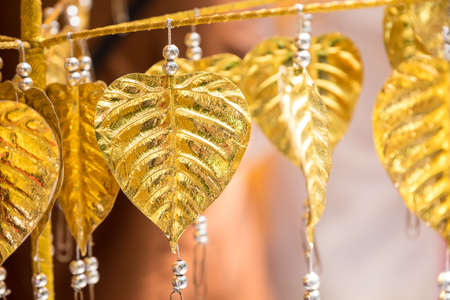 bo: Golden bo leaf are hanged on rope in the temple Stock Photo