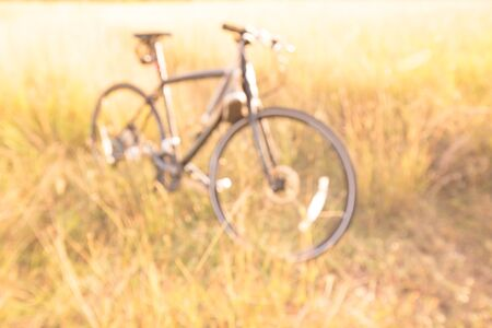 enviroment: bike blur in the field on the sunset. Stock Photo