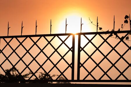 hinder: Iron wall on sunset