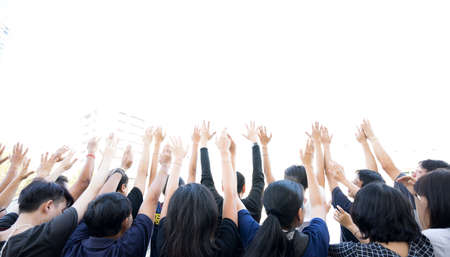Hands Up: Group of people lifting hands isolated white background Imagens