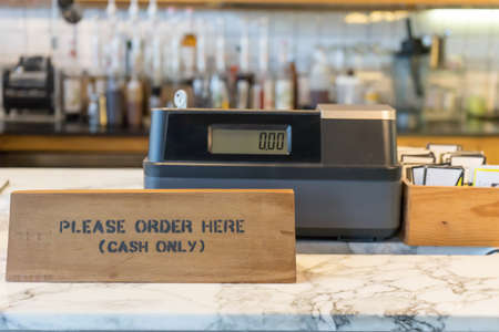 Please order here sign on wood wall in coffee shop Stock Photo