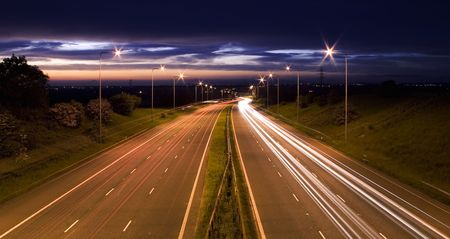 night time: Motorway of light, night time traffic floodlit by the lighting Stock Photo