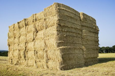 Hay bail Stack Cube with a great blue sky photo