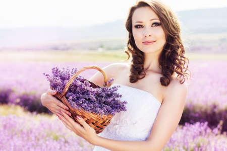 Beautiful bride posing at field of lavender photo