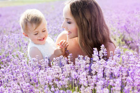 Mother and gaughter playing in lavender field