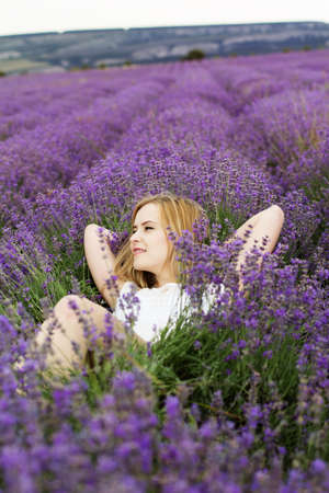 Adorable girl in fairy field of lavender photo