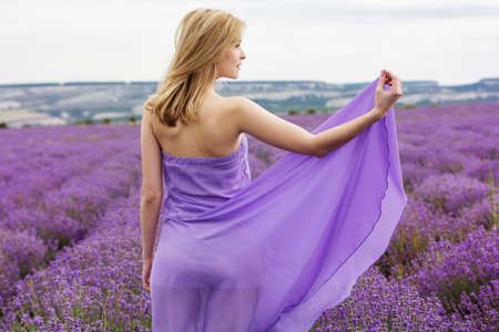 sexy blonde woman: Adorable girl in fairy field of lavender Stock Photo