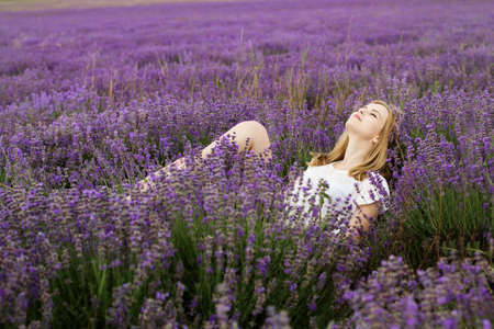 Adorable girl in fairy field of lavender Standard-Bild