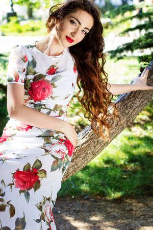 business dress: Beautiful girl  in green park