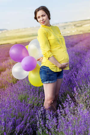 Beautiful pregnant woman in the lavender field photo