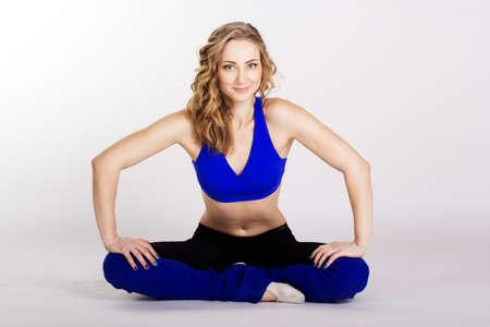 Young woman standing yoga pose photo