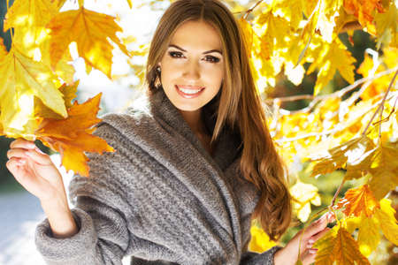 winter jacket: Young fashion girl in autumn park Stock Photo