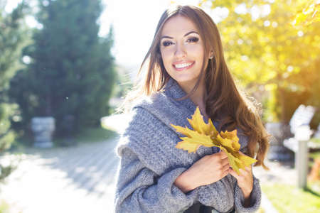 Young pretty teenager girl in autumn park Stock Photo