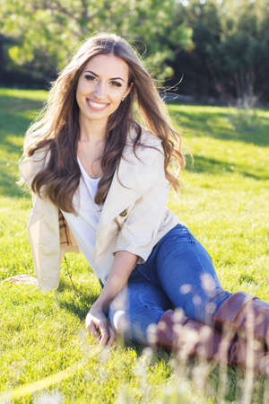 beautiful: Young pretty teenager girl sitting on green grass