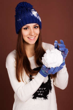 Teenager girl with snowball photo