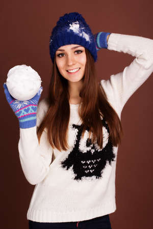 Teenager girl is holding snowball photo