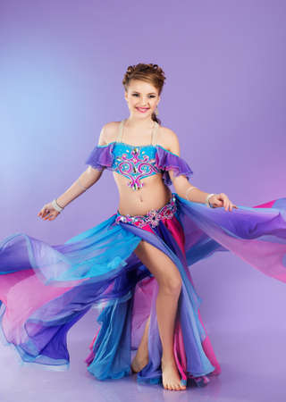 belly dancer: Beautiful belly dancer wearing a purple costume