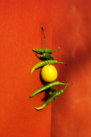 haveli: seven chili and one lemon hanging at the facade as prevent home from bad thing culture india