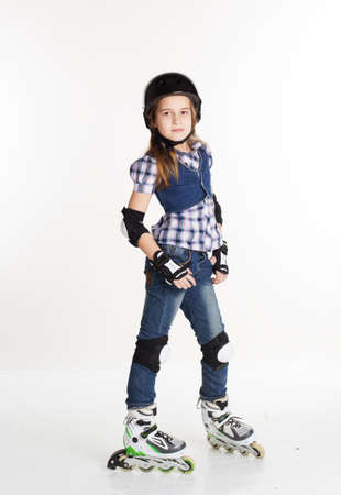 rollerskating: Cute girl is wearing jeans in roller skates on a white background, studio shoot