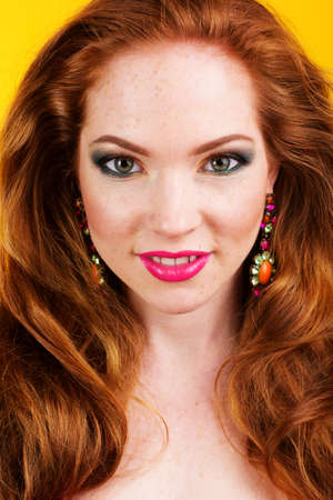 bangles hand: Portrait of beautiful girl with long red hairs is wearing fashion earrings
