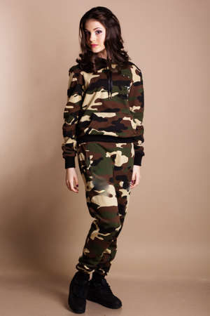 camoflauge: Portrait of young girl in military colored sports costume