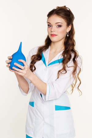 squirt: Pretty nurse girl is wearing uniform and holding blue squirt in hands