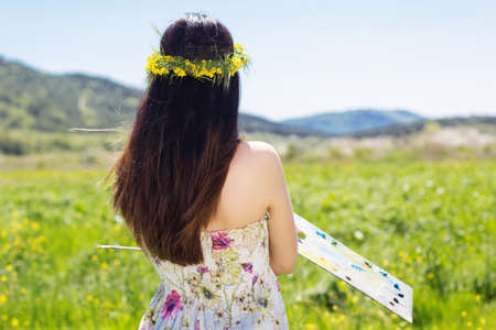 adult rape: Young female artist painting an floral landscape, summer time