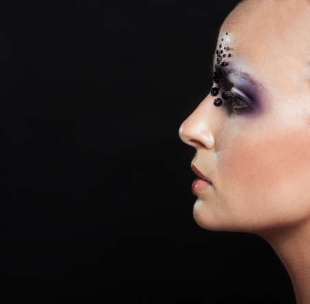bald girl: Portrait of bald girl with makeup with sequins on the face, perfect skin