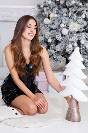 sexy girl: Happy girl with decorative small Christmas tree