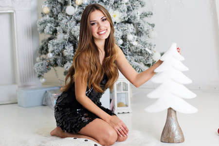 glamour: Happy girl with decorative small Christmas tree
