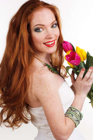 womans: Beautiful redheaded girl with colorful tulips, womans day