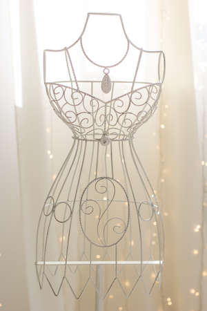 dress form: White vintage metallic hanger with wire dress form Stock Photo